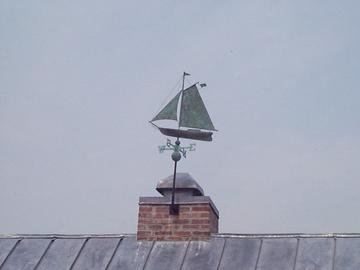 the proud little weather vane