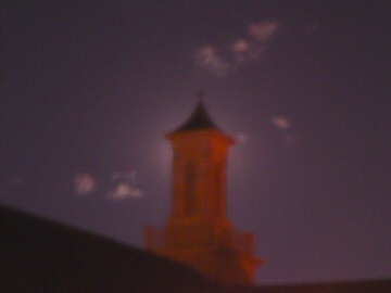 moon behind the steeple.